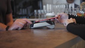 Concept NFC contactless payment. Making payment with mobile phone and pos terminal, printed check.