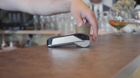 Concept NFC contactless payment. Making payment with credit card and pos terminal, printed check. a coffee shop stock footage