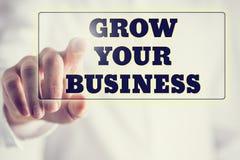 Concept nieuwe of startzaken - de woorden kweken uw zaken o Stock Foto
