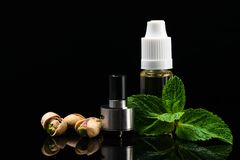 Concept of nut and mint flavors for electronic cigarettes on a black background royalty free stock images