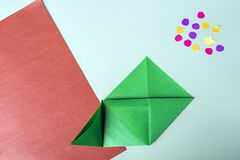 Free Concept Of DIY And Kid`s Creativity, Origami. Step By Step Instruction: How To Make Bookmark As Christmas Tree. Step 6 Bend Left Stock Photo - 204106070