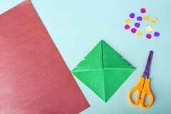 Free Concept Of DIY And Kid`s Creativity, Origami. Step By Step Instruction: How To Make Bookmark As Christmas Tree. Step 7 Make Cuts Stock Photography - 204106122