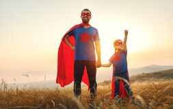 Free Concept Of Father`s Day. Dad And Child Daughter In Hero Superhero Costume At Sunset Stock Photo - 172733710