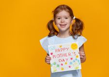 Free Concept Of Mother`s Day. Cheerful Laughing Child Girl With Postc Stock Images - 115517714