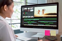 Free Concept Of Simple Operation Of Blogger And Vlogger, Hand Using Computer On Video Editor Works With Footage On Wooden Table. Royalty Free Stock Photo - 176242015