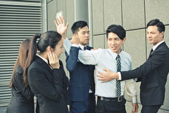 Concept of office bully. Or fight with men and women in the city Stock Image