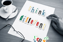 Concept office cup of coffee and word think different Royalty Free Stock Photos