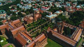 Aerial video of green summer city with view on Chernivtsi National Yurii Fedkovych University.