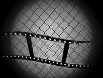 Concept old film strip. And wire fence Royalty Free Stock Photo