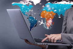 The concept of online booking with busineswoman and laptop Stock Images