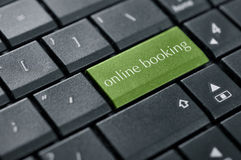 Concept of online booking. Words online booking on button of computer keyboard closeup royalty free stock images