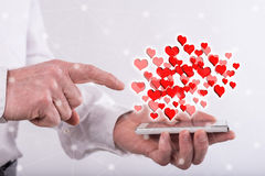 Concept of online dating. Online dating concept above a smartphone held by a man Stock Images