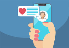 Concept of online dating and mobile chat app. Female hand holding modern. Bezel-free smartphone as  illustration with heart icon in chat window Stock Images