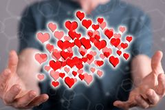 Concept of online dating. Online dating concept between hands of a man in background stock image