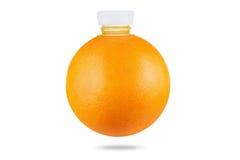 Concept, orange as bottle of fresh juice on white background Royalty Free Stock Images