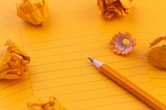 Concept Orange sheets of paper, pencil, stationery and empty space for your text.  stock photo