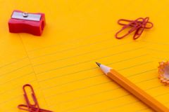 Concept Orange sheets of paper, pencil, stationery and empty space for your text.  royalty free stock photos