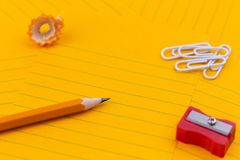 Concept Orange sheets of paper, pencil, stationery and empty space for your text.  stock image
