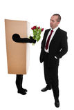 Concept: package delivery to convey flowers to a businessman Stock Image