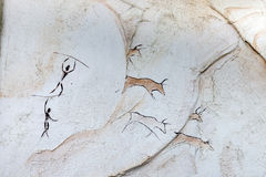 Concept painted on a rock, ancient people hunt animal buffalo with a spear Stock Images