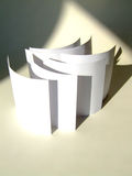 Concept Paper. White paper sheets rolling under a soft light. a photograph Royalty Free Stock Images