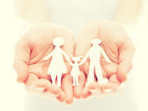 Concept. paper figures of family in hands Stock Images