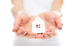 Concept. paper figurine house in hands Stock Images