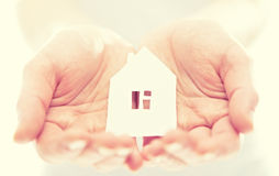 Concept. paper figurine house in hands Royalty Free Stock Photos