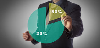 Concept Of Pareto Principle Or Eighty Twenty Rule. Unrecognizable manager with marker in hand approaching virtual pie chart illustrating the Pareto principle Royalty Free Stock Photo