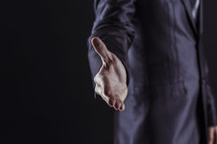 Concept of partnership in business: a businessman holds out his hand forward for a handshake Royalty Free Stock Image