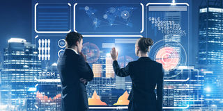 Concept of partnership and cooperation with people using virtual interface Stock Photo
