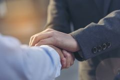 Concept partnership. Partners who is businessman and customer are touching hands promise to be honest in business. Hand shaking royalty free stock photos