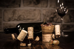 Concept Party with a lot of alcohol. Concept lot of Alcohol on a party, wine cork figures royalty free stock photo