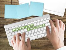 Passive Income concept on green keyboard button. Concept of passive income business trend. Passive Income words on green keyboard buttons Stock Images