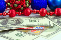 Concept: payment for the Christmas gifts plastic cards Visa and Royalty Free Stock Image