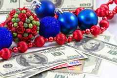 Concept: payment for the Christmas gifts plastic cards Visa and Royalty Free Stock Photo
