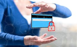 Concept of payment security. Payment security concept between hands of a woman in background Stock Photos