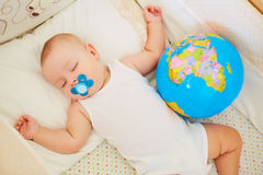 The concept of peace, protection, childhood.   Baby boy sleeping Stock Photo