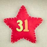 Concept pendant la nouvelle année, étoile rouge avec les nombres en bois 31 Image stock
