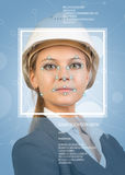 Concept of person identification. Beautiful builder in helmet. Face with lines. Frame and text. Blue background Royalty Free Stock Photography