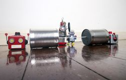 Concept phone line being cut of with retro robots. On a wooden floor royalty free stock photos