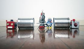 Concept phone line being cut of with retro robots. On a wooden floor stock photo