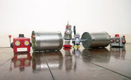 Concept phone line being cut of with retro robots. On a wooden floor stock image