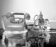 Concept phone line being cut of with retro robots. On a wooden floor solarized monochrome stock images