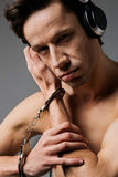 Concept photo of addiction - man fan the music Royalty Free Stock Photo