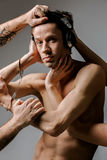 Concept photo of addiction - man in headphones and handcuffs Royalty Free Stock Photo