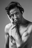 Concept photo of addiction - man in headphones and handcuffs Stock Photos