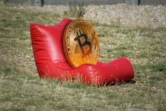 Bitcoin cryptocurrency on holiday sunbathing royalty free stock photo