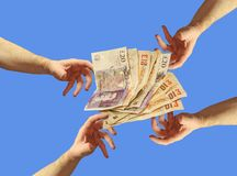 Free cash charity handout money giveaway. Concept photo of hands grabbing out for free cash charity handout giveaway etc stock photo