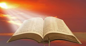 Holy spiritual light. Concept photo of holy spiritual light shining on open bible depicting divine enlightenment for mankind Stock Images